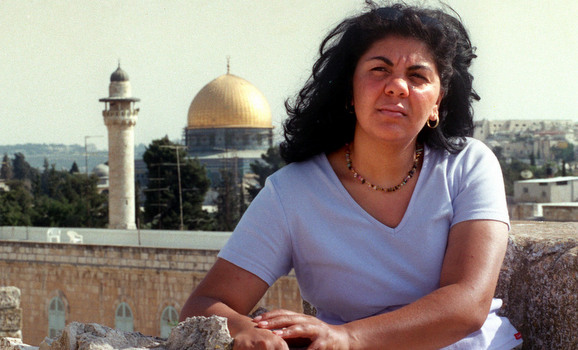 GYPSY AMOUN SLEEM SITS NEAR DOME OF THE ROOK IN JERUSALEM.