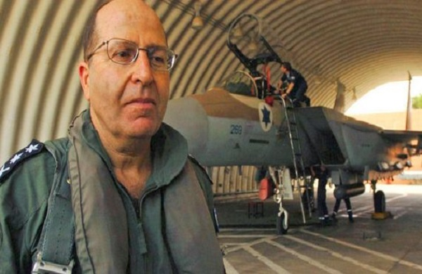 Israeli army Chief of staff Moshe Yaalon stands in front of a fighter jet at Natzarym air base in ...