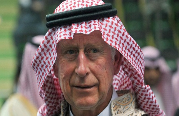 Britain's Prince Charles arrives to participate in the traditional Saudi dancing known as 'Arda' during the Janadriya culture festival at Der'iya in Riyadh